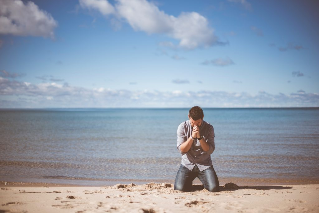 emotional man on a beach