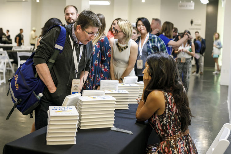 Leila does a book signing at CMX Summit 2017